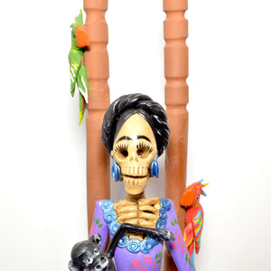 Catrina Frida on chair