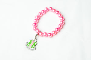AKA Pink Pearl Bracelet with Shield Charm