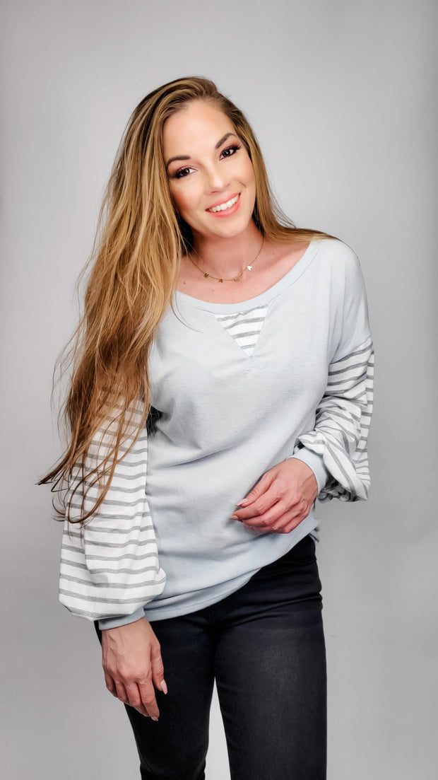 Long Sleeve Top Featuring V-Notch Detail and Stripe Contrast Sleeves