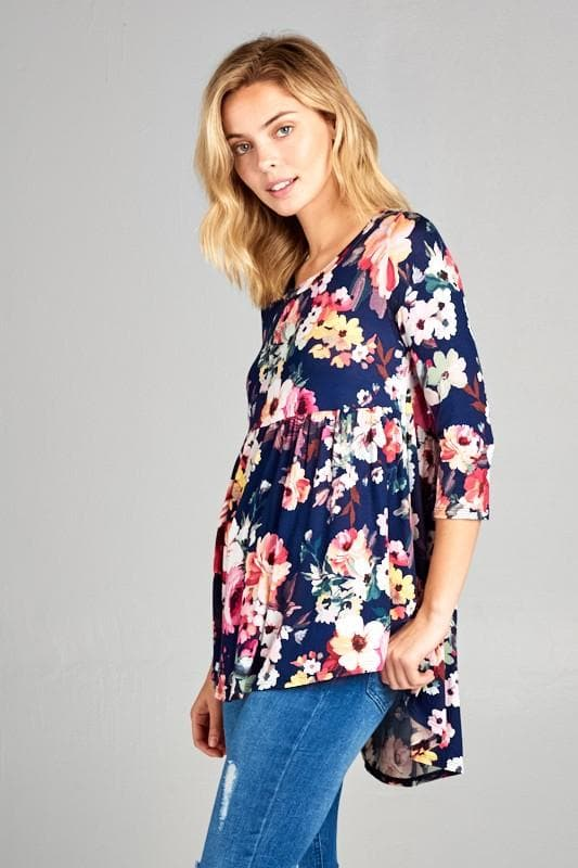 Plus Size Floral Baby Doll Top Featuring Round Neck and 3/4 Sleeves