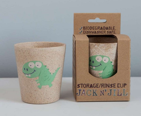 dinosaur rinse cup beside package