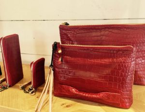 A selection of red leather accessories