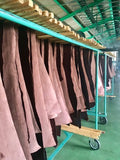 painted leather hanging to dry