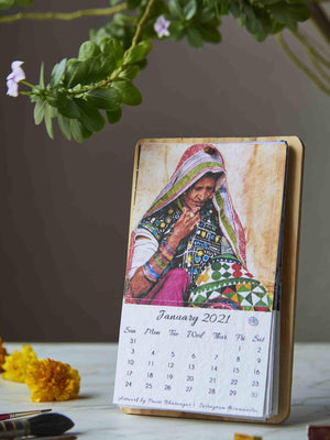 Eco-friendly plantable calendar with images of faces and places