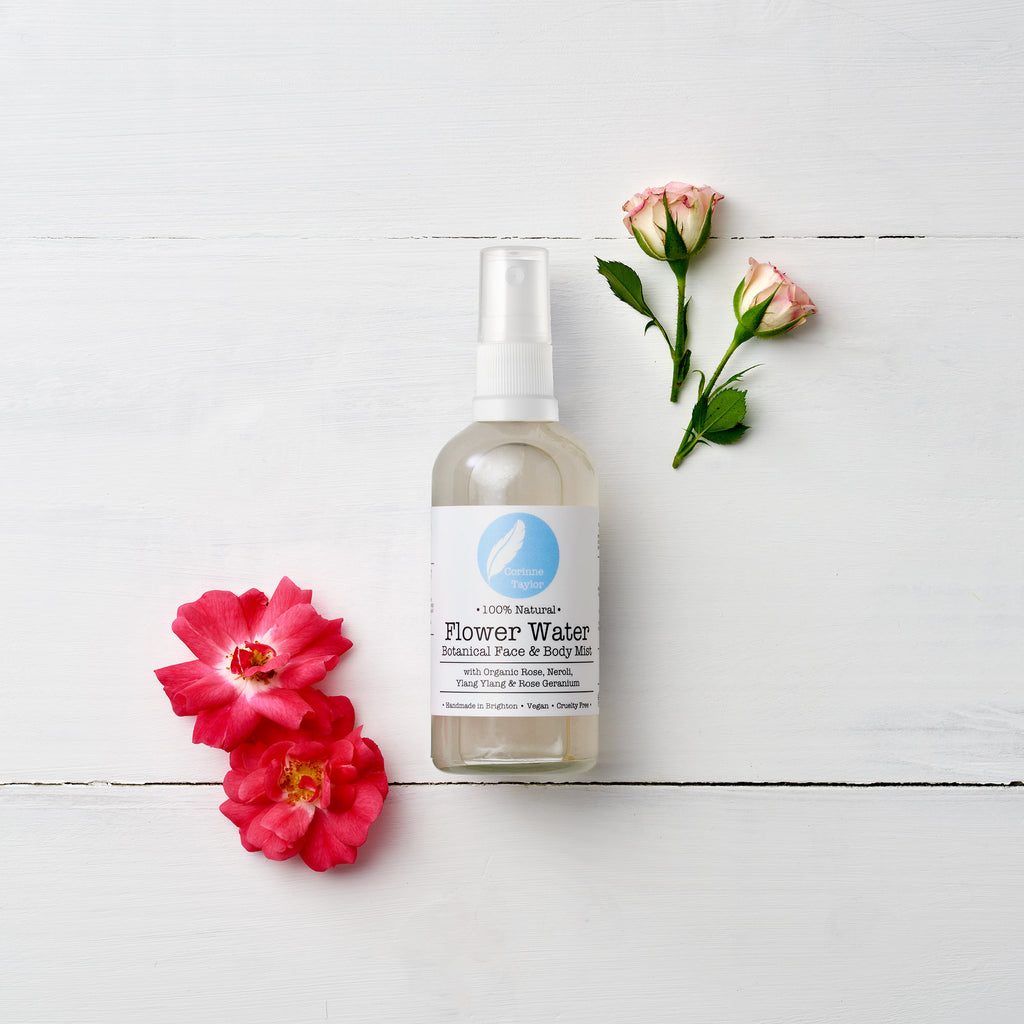 Flower Water Face & Body Mist by Corinne Taylor. 100% natural, vegan, plant based, cruelty free. A base of antioxidant rich organic Rose & Neroli Waters are infused with skin soothing Aloe Vera and a balancing organic essential oil blend of Rose Geranium and Ylang Ylang.