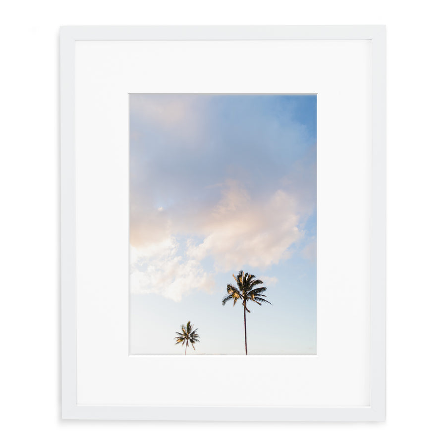 Framed photo of palm trees in hawaii kauai in white wood frame with white mat.