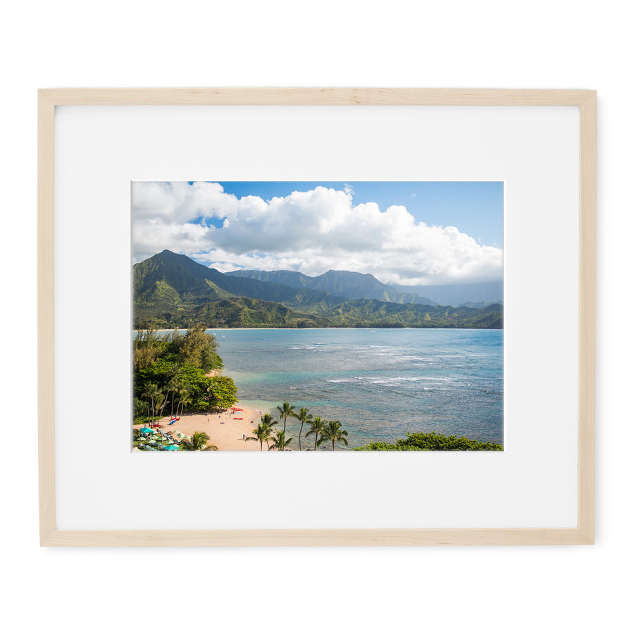 Framed photo print of Hanalei Bay view from Princeville Resort with a natural wood frame with a white mat.