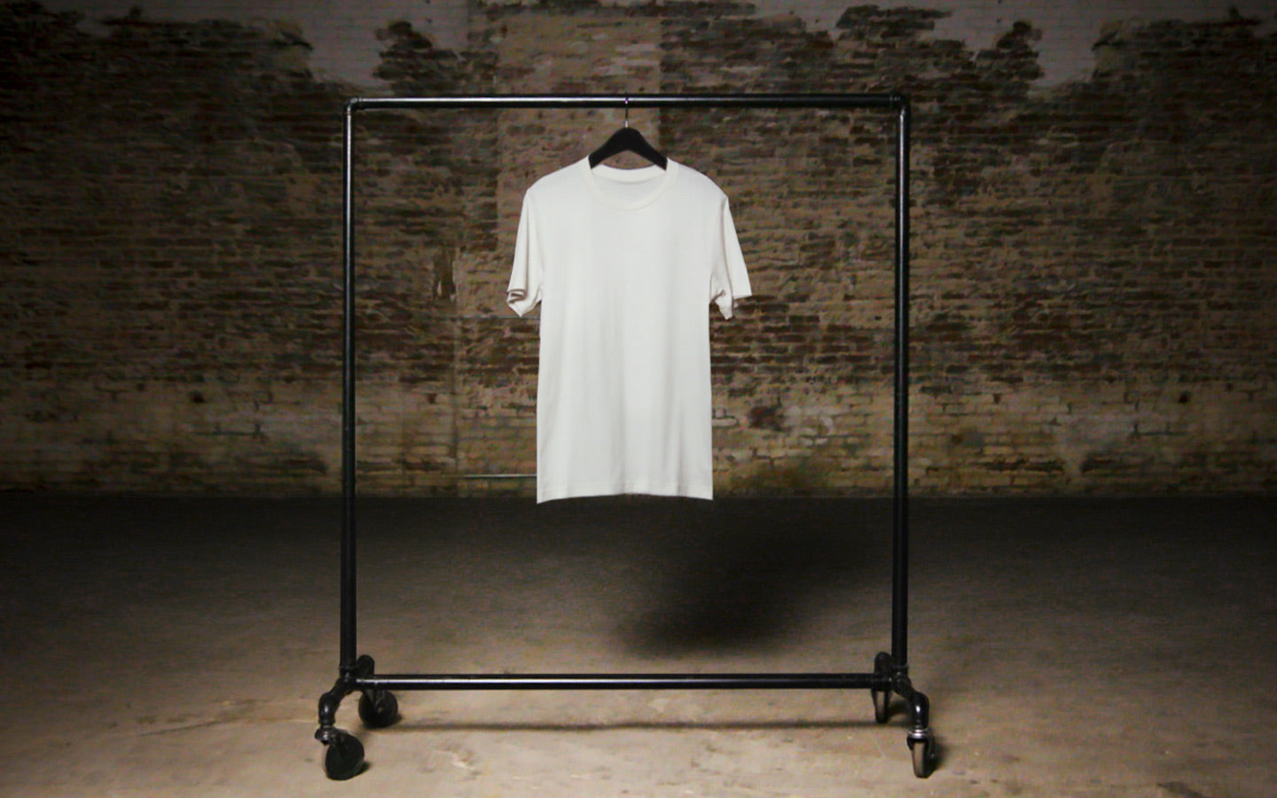 bella 3001 white t hanging on rack