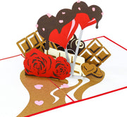 PopLife Pop-up card features sweet chocolates, heart lollipop coated with chocolate and red roses