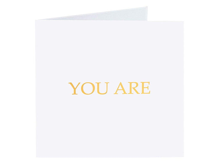 "Front cover of card with light grey color features ""You are"" note"