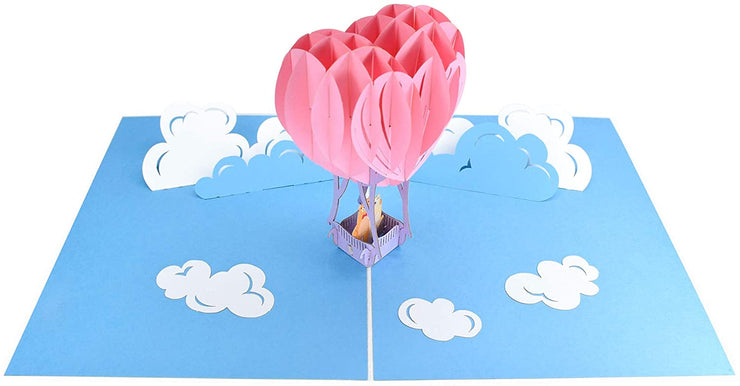PopLife Pop-Up card complete with blue sky and fluffy white clouds backdrop
