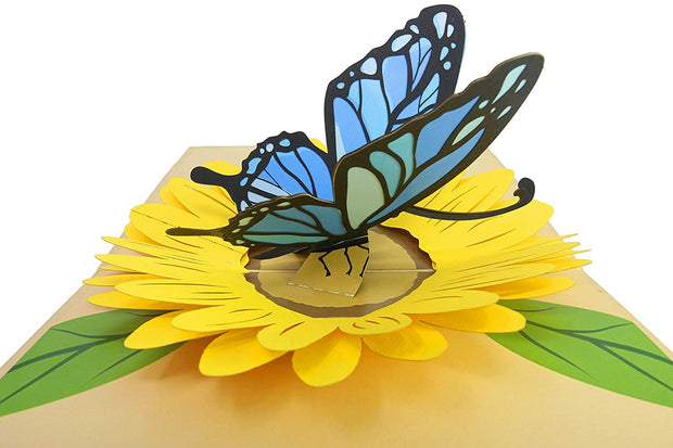 Features blue butterfly in a yellow sunflower