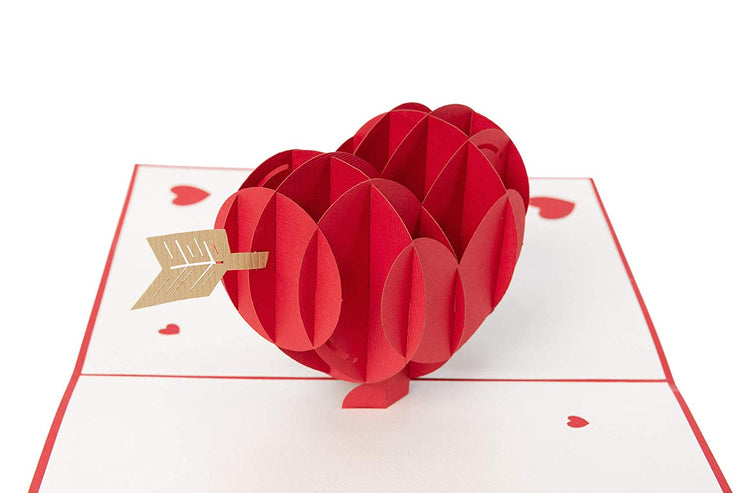 Card features red heart pierced by an arrow