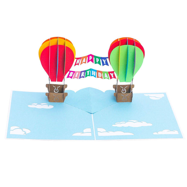 PopLife Pop-Up card features Rainbow colored flying hot air balloons with happy birthday banner in the sky