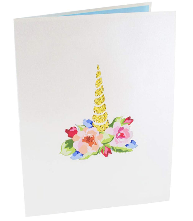 Front cover of card with light grey color features unicorn horn with colorful flowers around it