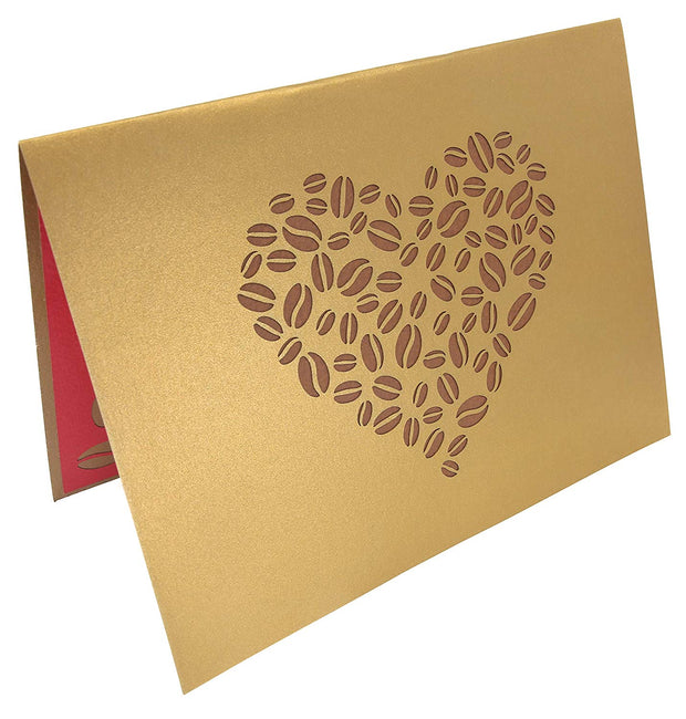Front cover of card with gold color features coffee bean in the shape of a heart