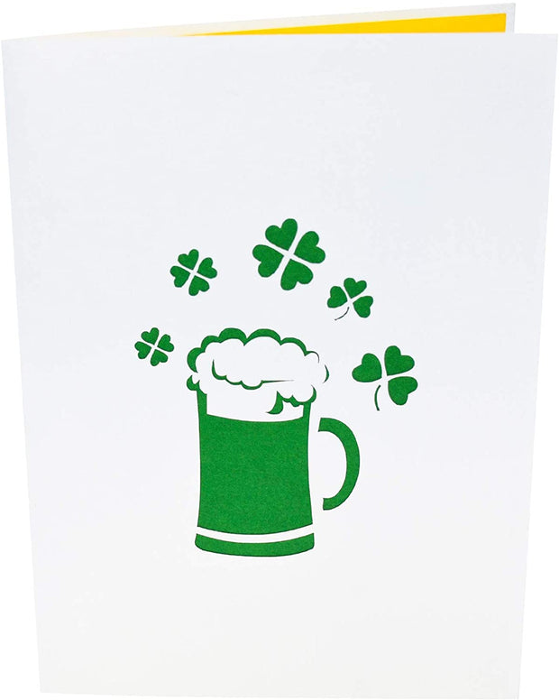 Front cover of card with light grey color features beer mug and clover leaves