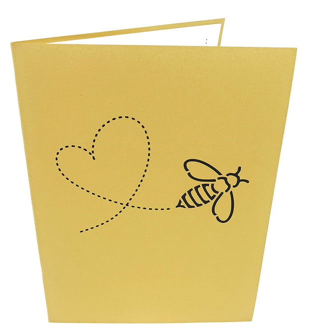 7.5 inches by 6 inches brown card with a heart and bee cutout