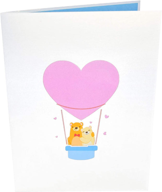 Front cover of card with light grey color features a heart pink balloon
