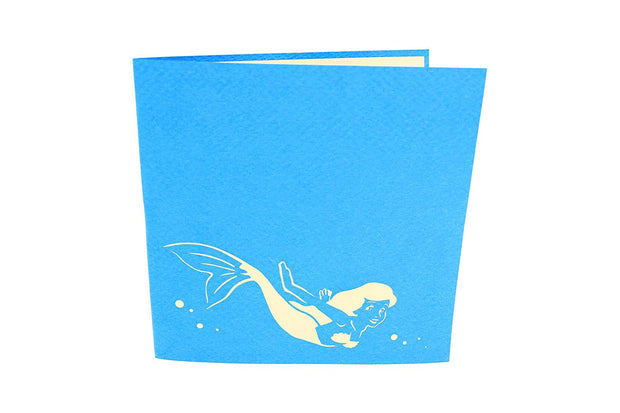 6 inches by 6 inches blue card with a swimming mermaid cutout