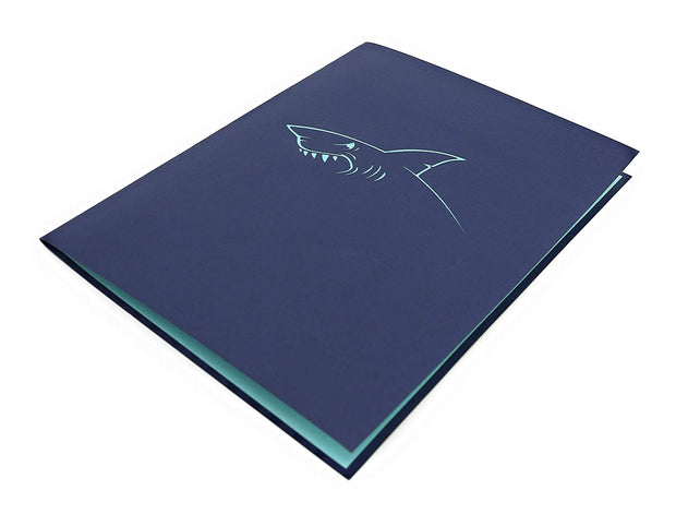 Front cover of card with blue color features shark's jaws design