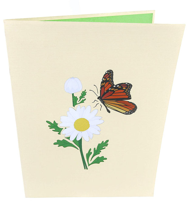 Front cover of card with beige color features monarch butterfly and white daisy flower