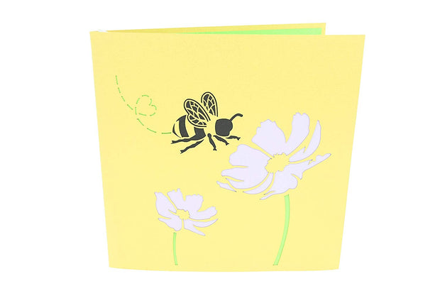 Front cover of card with yellow color features honey bee and flowers