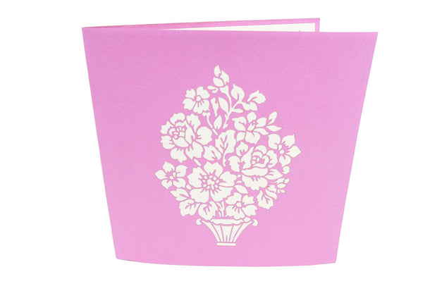 Front cover of card with purple color features beautiful flowers in a vase