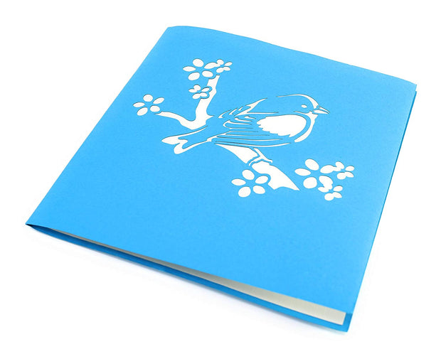 Front cover of card with blue color features bird on a branch