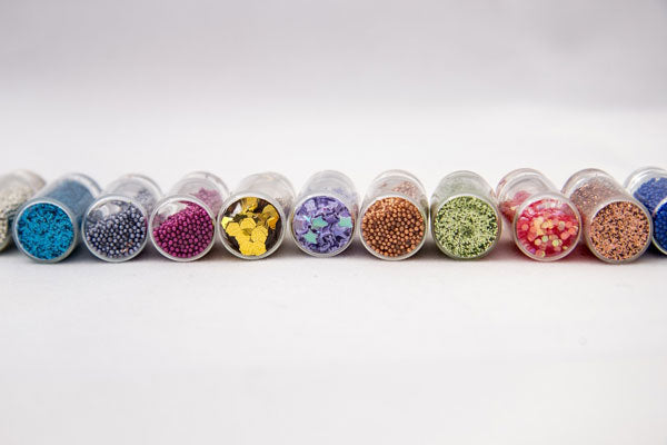 row of jars filled with beads