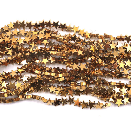 6mm star gold hematite beads, glossy, 1 strand, 16 inches, approx. 70 beads.
