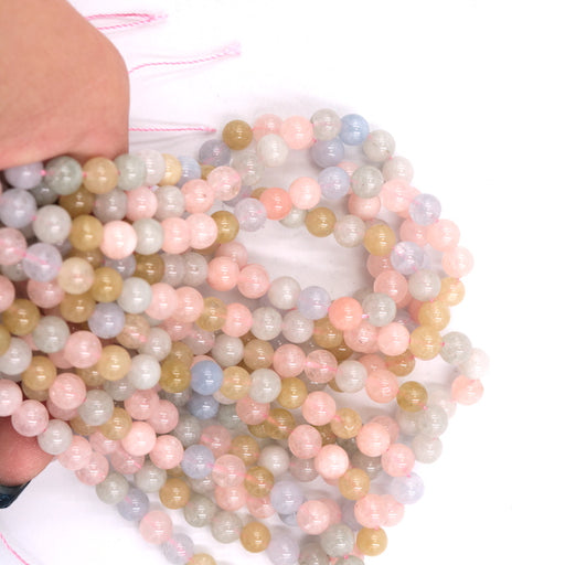 6mm round morganite beads, mixed beryl, glossy, 1 strand, 16 inches, approx. 66 beads.