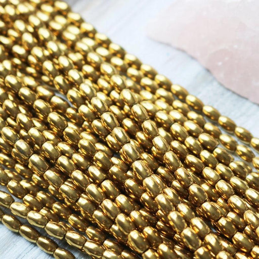 gold hematite, 4mm x 6mm, barrel, glossy, 1 strand, 16 inches, approx. 66 beads.