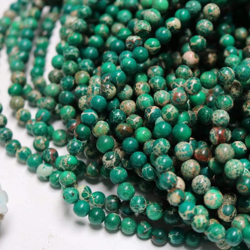 Green impression jasper, glossy, approx. 66 beads.
