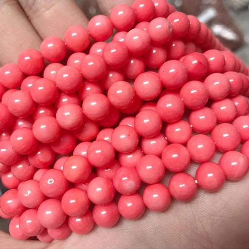 pink coral, round, glossy, approx. 48 beads.