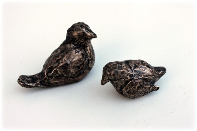 Small bronze bird sculptures