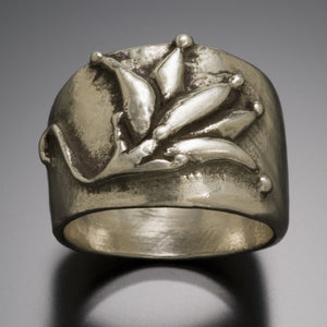 lotus blossom ring with OM engraved inside