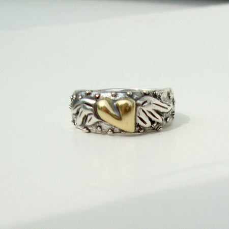 te amo ring silver with rose gold flying heart symbol