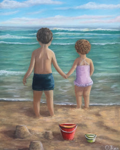 Girl and boy with red bucket on the shore