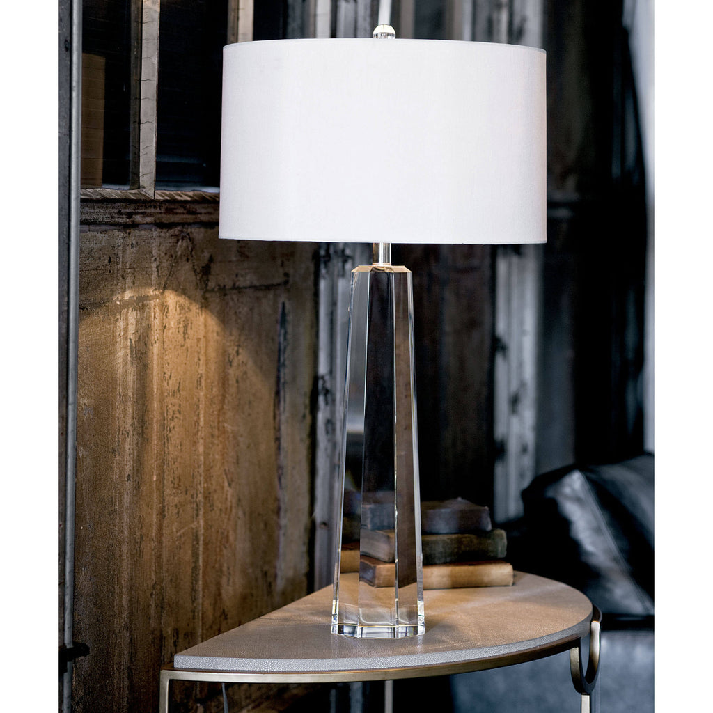clear table lamp sitting on end table