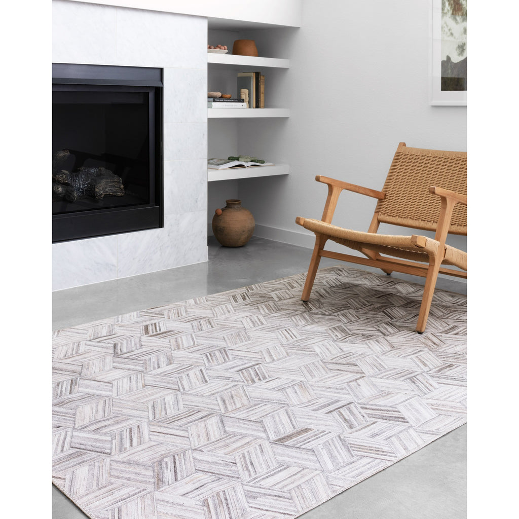 LT GREY AND IVORY MADDOX RUG IN LIVING ROOM NEXT TO FIREPLACE