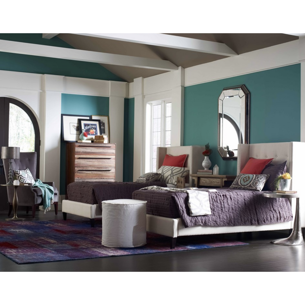 colorful bedroom with grey velvet chair