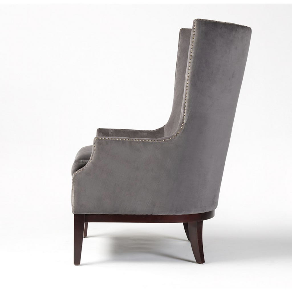 side view of grey velvet chair