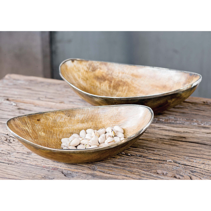 horn bowls with brass trim on wood top