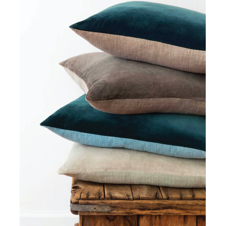 stack of lagoon two toned pillows