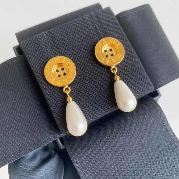 CHANEL 20A Gold Metal Button Pearl Dangle Earrings - Dearluxe.com