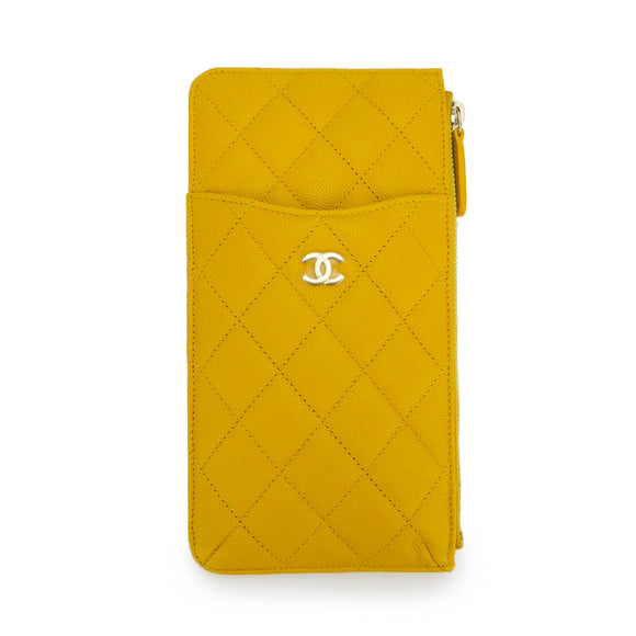 CHANEL Phone Pouch in Yellow Caviar - Dearluxe.com
