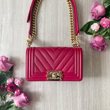 CHANEL Small Chevron Boy Bag in Dark Pink Lambskin - Dearluxe.com