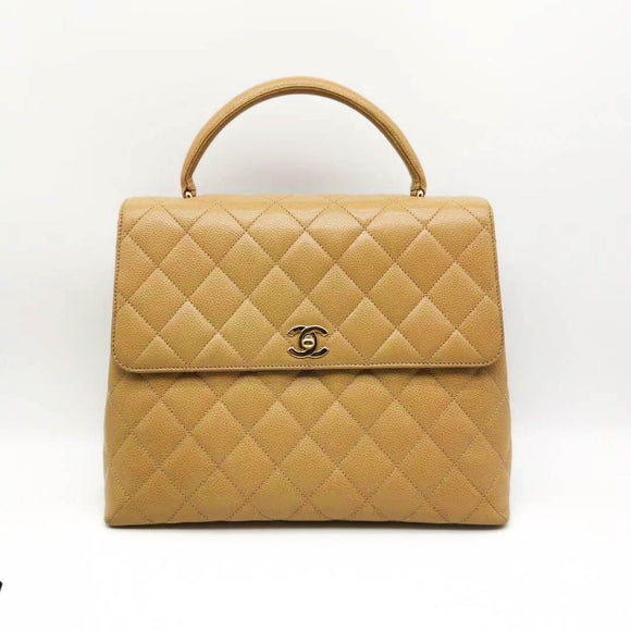 CHANEL Vintage Kelly Bag in Beige Caviar - Dearluxe.com