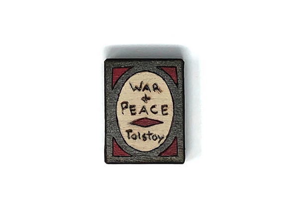 war and peace wooden book magnet